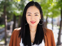 Chu (Peter Grifoni) Tags: peter grifoni gtpete gtpete63 the human family group street stranger portrait portraiture olympus omd em1 zuiko 45mm f18 newtown chu woman black hair red lips her banana hand made jewellery artwork south korean