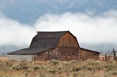 1831e Mormon Row-- in the clouds (jjjj56cp) Tags: barn historic homestead wyoming grandtetons 1860s pioneer jacksonhole wy grandtetonnationalpark mormonrow antelopeflats moultonbarn jennypansing