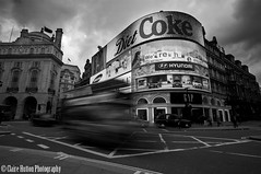 (Claire Hutton) Tags: city uk longexposure england blackandwhite bw signs motion bus london monochrome car lens prime lights mono movement traffic taxi wideangle piccadillycircus busy filter le dietcoke csc tdk ndfilter neutraldensity nd32 5stop sonynex5r samyang12mmf20