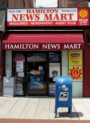 Store front, Hamilton, Baltimore, Maryland 2012 (A CASUAL PHOTGRAPHER) Tags: newspapers festivals maryland baltimore mailboxes magazines advertisements conveniencestores bridgecameras hamiltonstreetfestival canonpowershotsx20is hamiltonnewsmart