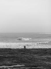 Lost soul (Tim Bow Photography) Tags: bw wales landscape waiting surf waves alone vision british welsh anticipation moment secretspot porthcawl blackandwhitephotography bodyboard fadinglight bodyboarder standingalone lonelyperson timboss81 timbowphotography