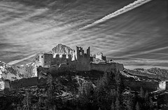 Mountain Ruins (StevenH.) Tags: sky blackandwhite mountains alps castle clouds ruins sony hdr a99