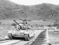 A Centurion tank passes over a pontoon bridge over the Imjin River.