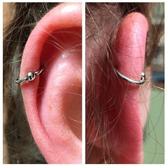 Helix piercing by Taylor Bell