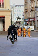 Work and Play (VelvetJones_) Tags: street orange work canon 50mm play workmen glasgow candid flip skateboard skater trick 70d