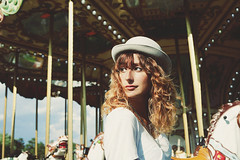 Emotion's Carousel (andreannelupien) Tags: carousel fair circus light girl portrait magic beautiful play joy summer sky hat curly ginger