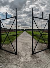 Open door (Perurena) Tags: puertas doors metal cadena chain entrada camino path campo campodeconcentracin exterminio muerte death judios jews prisioneros auswitch polonia