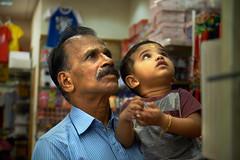 GrandFather and GrandSon moment (Ramesh Kurup) Tags: fuji fujifilm xt10 kid grandfather grandson chinatown singapore