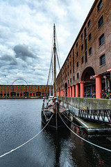 Sitting in the Dock (cathbooton) Tags: albertdock dusk daysend boat dock liverpool reflection water wheel gallery art tate summer july city building waterfront history historic warehouse heritage maritime