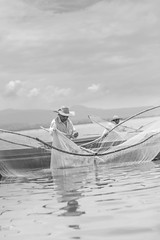 Fisherman (Luis Montemayor) Tags: sky lake water clouds lago fisherman agua fishermen cielo nubes michoacan pescador pescadores