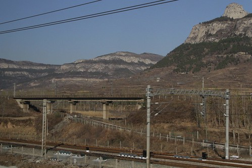 Tangle of railway lines cross in the shadows of Mount Tai