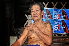 Old man protected by sacred ink of Yantra tattoo