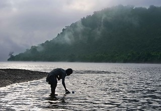 In a winter morning a girl collecting water from kaptai lake,  kaptai lake is the largest man made lake in South Asia.
