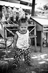 Cambodia Baby Legs (Heather Simonds) Tags: street travel portrait people baby white black monochrome asian outdoors nikon asia cambodia dancing outdoor streetphotography portraiture travelphotography portraitphotography outdoorsphotography outdoorphotography httpheathersimondsphotographycom
