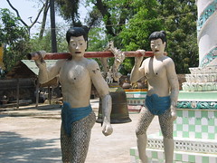 Statues Carrying a Bell