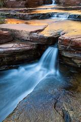 Golden flow (Rod Burgess) Tags: dalesgorge karijininationalpark westernaustralia canon5dmkii canon1635f4l australia glow milkywater longexposure reflections outdoor waterfall