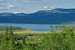 Lake Laberge View (MIKOFOX  Show Your EXIF!) Tags: marsh canada bay lake yukon fujifilmxt1 water mountains june spruce clouds landscape xt1 showyourexif summer lakelaberge mikofox xf18135mmf3556rlmoiswr
