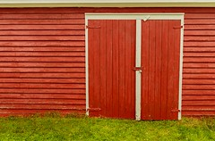 Red Door (Karen_Chappell) Tags: red door shed paint painted wood wooden green bayroberts shorelineheritagewalk newfoundland nfld rural canada building architecture clapboard avalonpeninsula