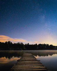Under the stars (Dejan Hudoletnjak) Tags: nightsky landscape panorama pier nightlandscape underthestars movingclouds silkywater lake nightlake water stars milkyway slovenia relaxing