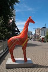 Raise (Jocey K) Tags: bridge trees newzealand christchurch sky sculpture tree s giraffe standstall giantfibreglassgiraffesculptures artistalejandradiaz raiseno8
