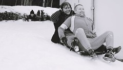 having fun in winter (Anamaria Brigitte) Tags: family winter bw white snow black love smile yard fun outside couple play adult time good lovers together laugh positive feeling sled grownup