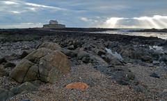 Eglwys Bach Y Mor (RHughes5) Tags: light sky orange sun building history church water landscape coast rocks stones geology tidal beams