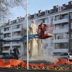 cleaning Juliana van Stolberg (milov) Tags: morning flowers people sculpture art water statue square cherrypicker cleaners denhaag cleaning cropped thehague ricohgr highpressurecleaner julianavanstolberglaan julianavanstolberg