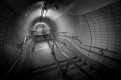 Into the labyrinth (D A Scott) Tags: blackandwhite london station underground tube perspective tunnel embankment