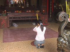 Praying in HCMC Temple