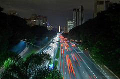 Sao Paulo Iconic Expressway (Carlos Alkmin) Tags: road city bridge light red cidade brazil sun color reflection luz sol car horizontal brasil skyline architecture modern night speed river outdoors photography avenida saopaulo citylife trails nopeople panoramic via sampa sp obelisk noite ibirapuera expressway saintpaul avenue transito obelisco connection sanpablo sanpaolo entardecer lighttrail traveldestinations colorimage veloz arteria 23demaio buildingexterior expressa saopaulostate campobelo