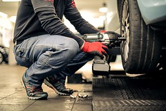 How do I fix a flat? (tipsofguy) Tags: italy white man car cane work air platform tires gloves passion bolts worker strength pressure mechanic dealership employee gearbox commitment caucasian
