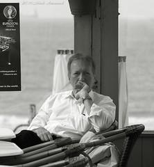 Portrait (Natali Antonovich) Tags: portrait monochrome seaside cafe blankenberge lifestyle stare romantic relaxation seashore terras seasideresort reverie romanticism belgiancoast seaboard