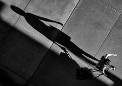Small Woman, Big Shadow (llabe) Tags: shadow woman diagonal diagonallines blackandwhite urban downtown tacoma washington nikon d750