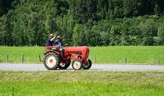Out travelling with the tractor (harald.bohn) Tags: austria traktor rd red tractor green grnn fields jorder porsche affof 2016 kitzbhel alpene sterrike