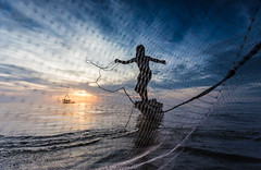 The Catch (This Photo was selected by National Geographic Your Shot's Daily Dozen on 3 Aug 2016) (wu di 3) Tags: thailand morning sunrise sea net fishing asia fisherman boat pathalung