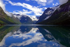 Where time moves at its own pace (mark.paradox) Tags: norway sognogfjordane nordfjord lovatnet lake coastline water fjord nature landscape clouds sky mountains scenery view reflection            lookgoldlastlevel