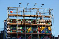 Scaffold (Florian Btow) Tags: 135mm london architecture construction graffiti colorfil lamps blue sky site scaffold
