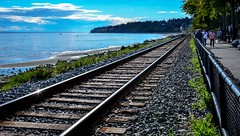 Making Tracks (Images by Christie  Happy Clicks for) Tags: whiterock bc canada train traintracks beach sunny nikon d5200 seascape seaside oceanview ocean people scenic britishcolumbia metrovancouver southsurrey whiterockbeach fence
