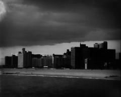 Coney Island after the storm (Giovanni Savino Photography) Tags: coneyisland darkclouds buildings beach largeformatphotography 4x5camera xrayfilm storm magneticart giovannisavino