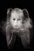 Behind of dust (Mikko Vuorinen) Tags: ihmiset meviart mikko jauhokuvaus jauhot lapset perhe vuorinen girl portrait dust powder blow cloud hands look child bw