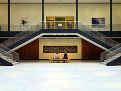 Art Museum of Utica, New York (duaneschermerhorn) Tags: art gallery museum pollack jacksonpollack painting artwork sculpture stairs steps people women talking bench