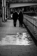 Street Photography, B&W Walking People (louisverplancken) Tags: street bridge light people bw white black reflection ice water canon walking photography eos blackwhite belgium pavement tournai doornik 100d