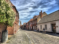 Biking Through Bruges, Belgium (` Toshio ') Tags: street city sky people tree tower history bicycle architecture clouds buildings europe european village belgium belgique brugge cobblestone bruges europeanunion belfort iphone toshio belforttower belfryofbruges iphone5s