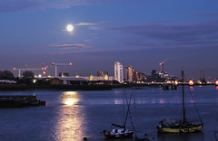 Full Moon reflection on the Thames River Greenwich docks (Tej Dyal) Tags: moon thames docks river full moonrise 16mm samyang greewhich