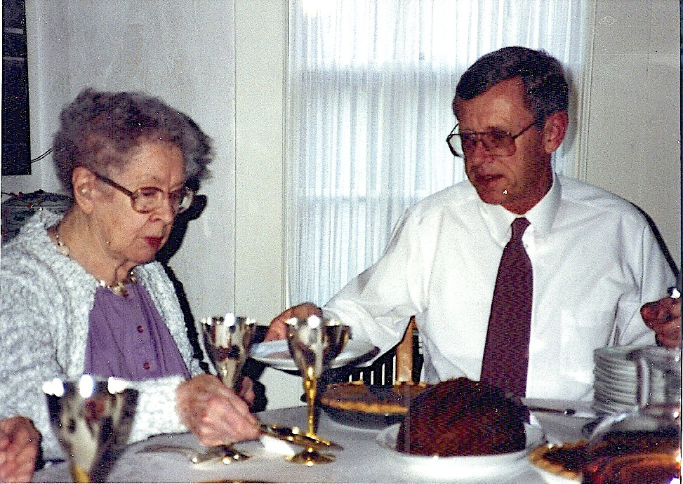 Nana Newell and Dad serving Plum Pudding