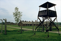 all along the watchtower (Ron Layters) Tags: leica fence sad poland slide tragedy transparency barbedwire fujichrome auschwitz r3 unbelievable watchtower birkenau concentrationcamp sensia dormitories oswiecim leicar3 ronlayters slidefilmthenscanned camphouses onemilliondead