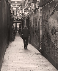 Waliking down the street (laurie5w) Tags: street old ireland man walking blackwhite cork tags poetic flags hidding fashioned cantseeme