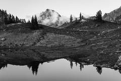 Forming (zh3nya) Tags: trees blackandwhite terrain mountain lake reflection texture clouds washington pond northwest meadow peak craggy alpine pacificnorthwest wa jagged tarn pnw northcascades subalpine