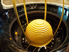 This ball keeps The skyskraper Taipei 101 move to the other side when the building moved during hurricnes, hard winds, earthquakes etc, to keep the structure more safe!