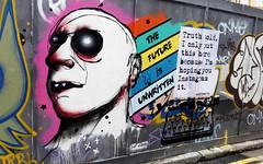 The Future is Unwritten (id-iom) Tags: street uk england urban streetart man london art face wall graffiti cool rainbow eyes stencil paint arts spray drip future vandalism spraypaint eastend unwritten hoardings idiom aerosolpaint globalstreetart